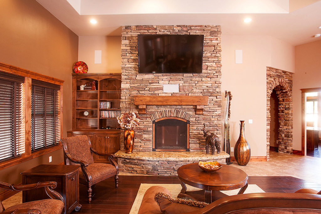 The beautiful wood built-ins and stone in the living room makes this space feel warm and inviting.