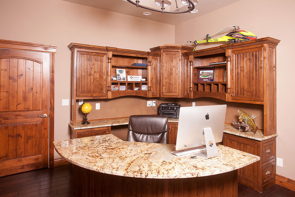 This office space has custom cabinets, granite countertops and is large and inviting with a lot of natural light.