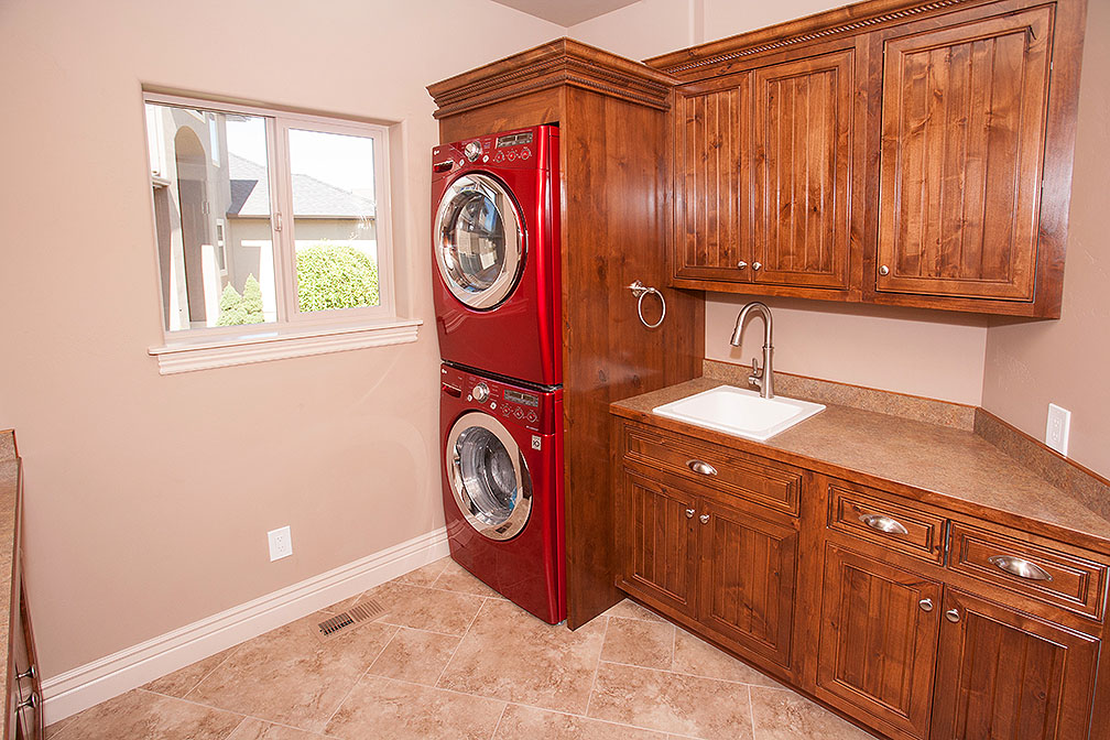 Laudry room with custom cabinetry and ample counter space