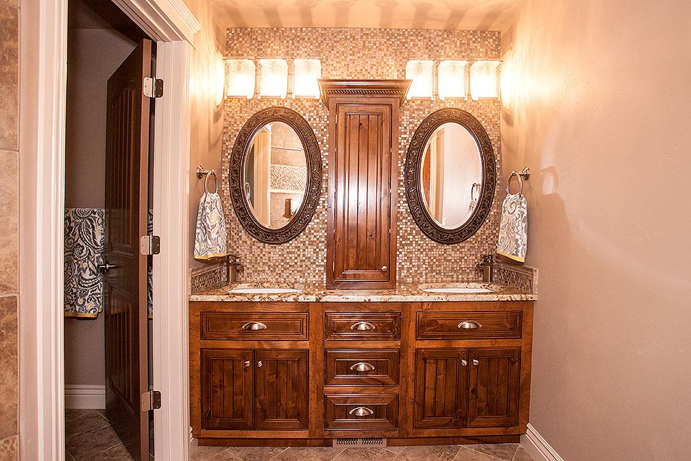 Stunning mosaic tile behind mirrors