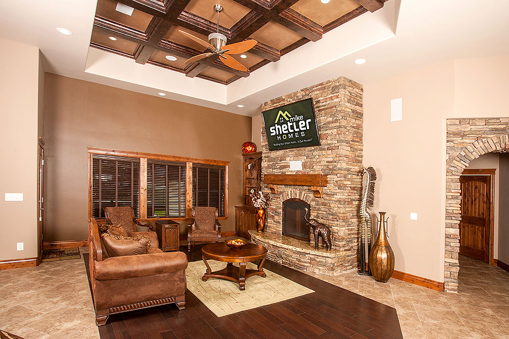 Painted tray ceilings sparing no details coupled with a custom fireplace.