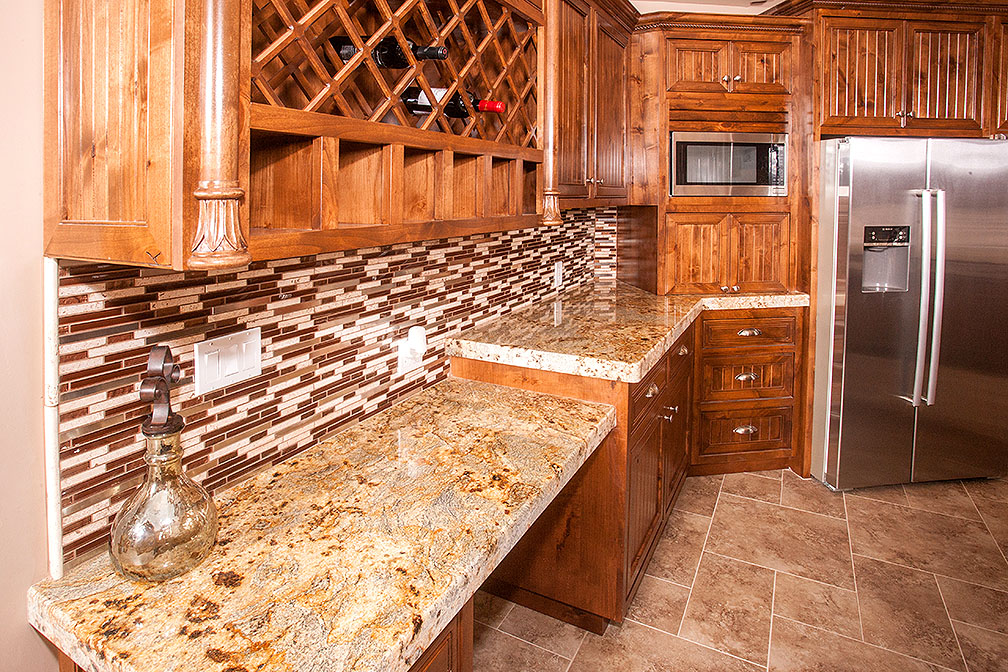 Built in wine rack adorns this perfect kitchen.