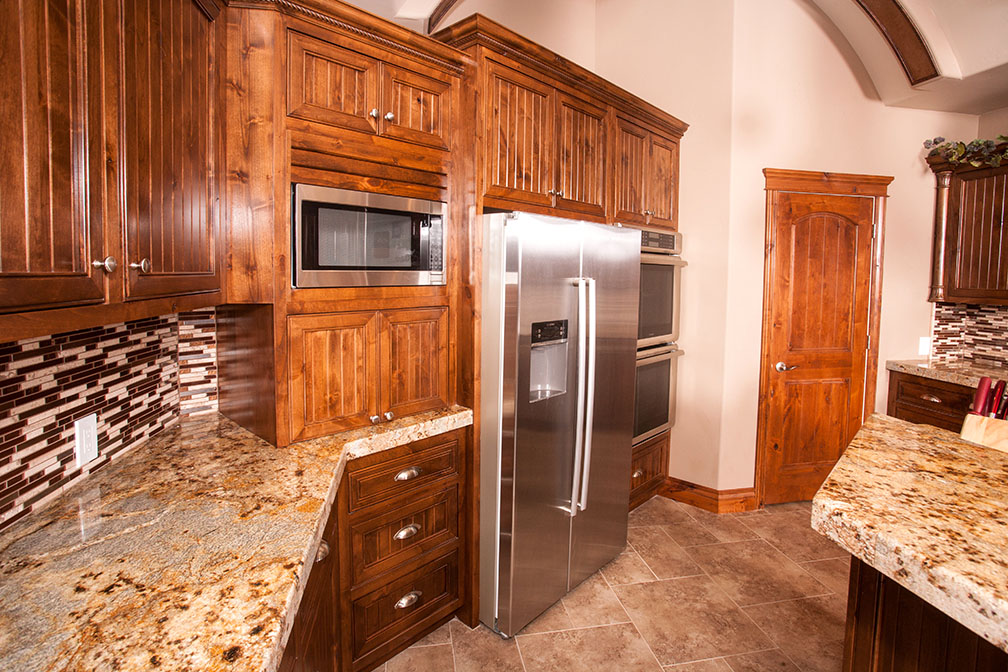 This kitchen has state-of-the-art appliances, beautiful backsplash, oversized pantry and island.