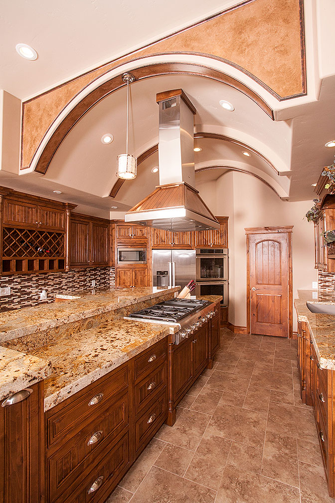 Stunning granite, double ovens and gas range, built in wine rack, oversized kitchen island and pantry.