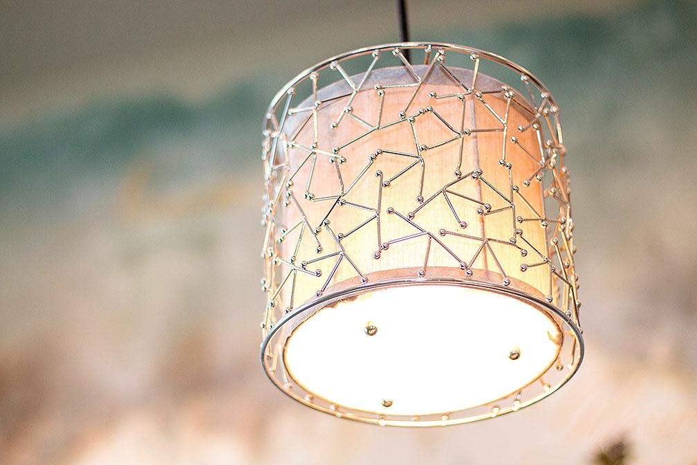 Beautiful pendant lighting above kitchen island.