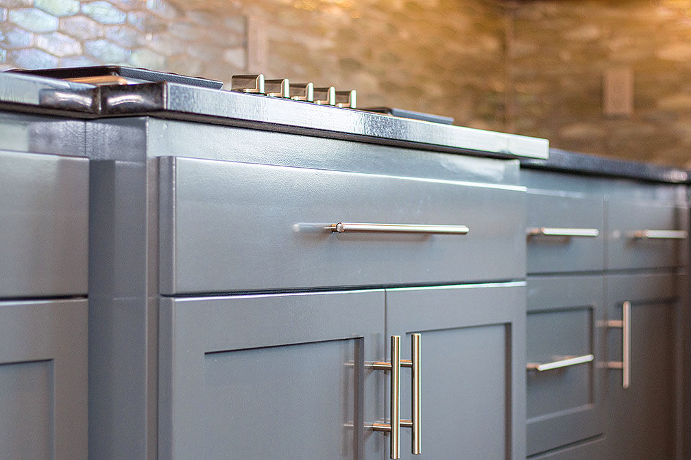 Gray shaker cabinets adorned with brushed nickel hardware