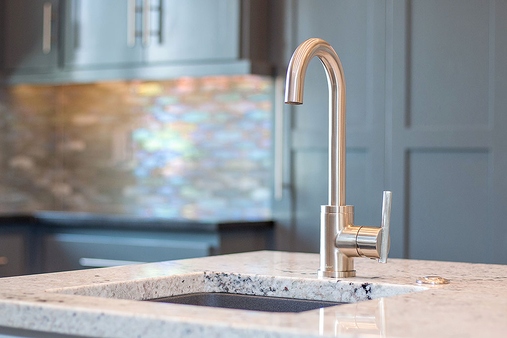 Kitchen island prep sink and gooseneck faucet makes for a cooking paradise