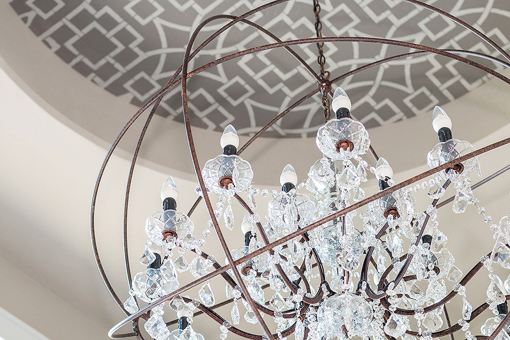 Crystal chandelier hanging in the entry way.