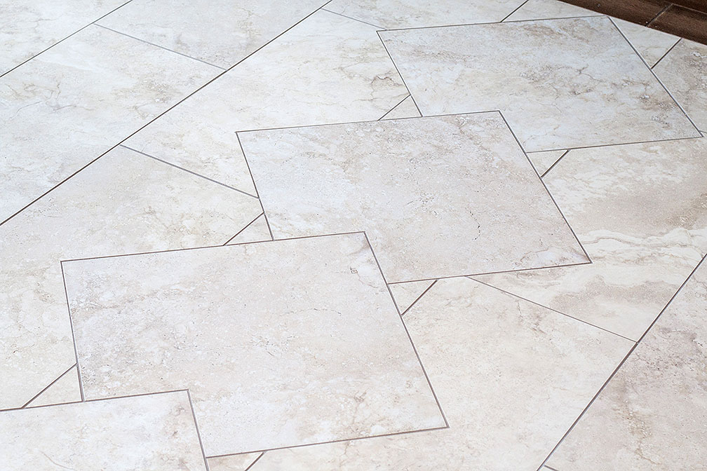Polished travertine tile graces the entry way.