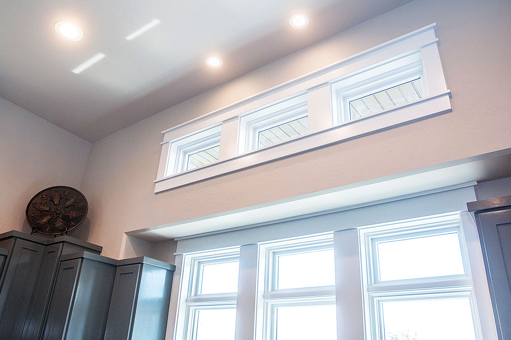 Deep window casing in the kitchen adds more detail.