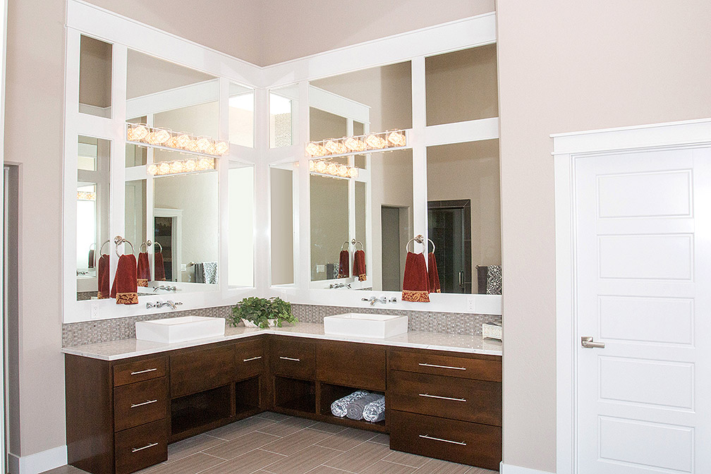 His and hers vessel sinks, basket weave tile, custom framed mirrors and granite countertops...what's not to LOVE!
