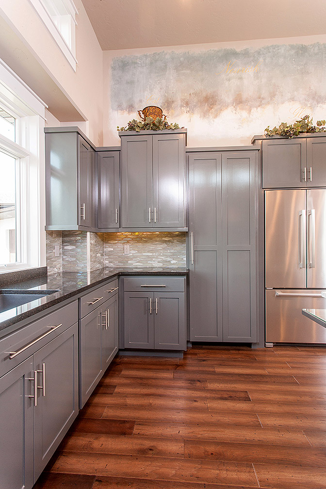Disguising the pantry door as the gray shaker style cabinets was brilliant—keeping the flow and design of this kitchen perfect.