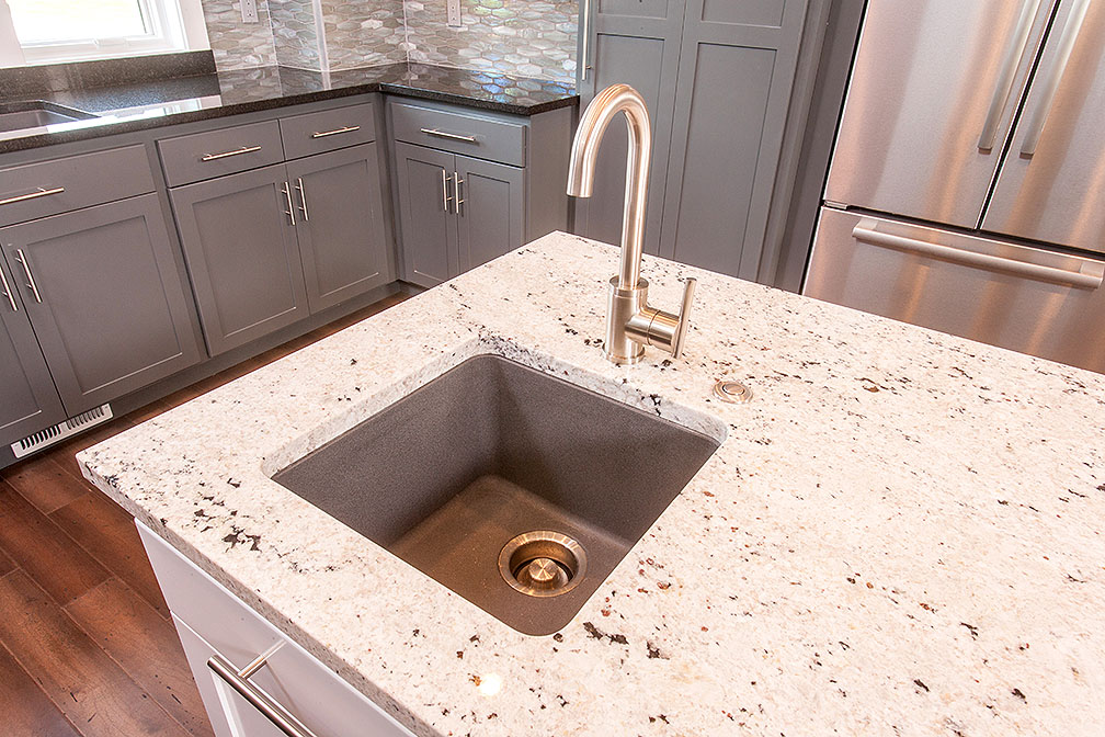 Granite countertops, kitchen island prep sink and state-of-the-art appliances—what more could a person ask for from a kitchen!