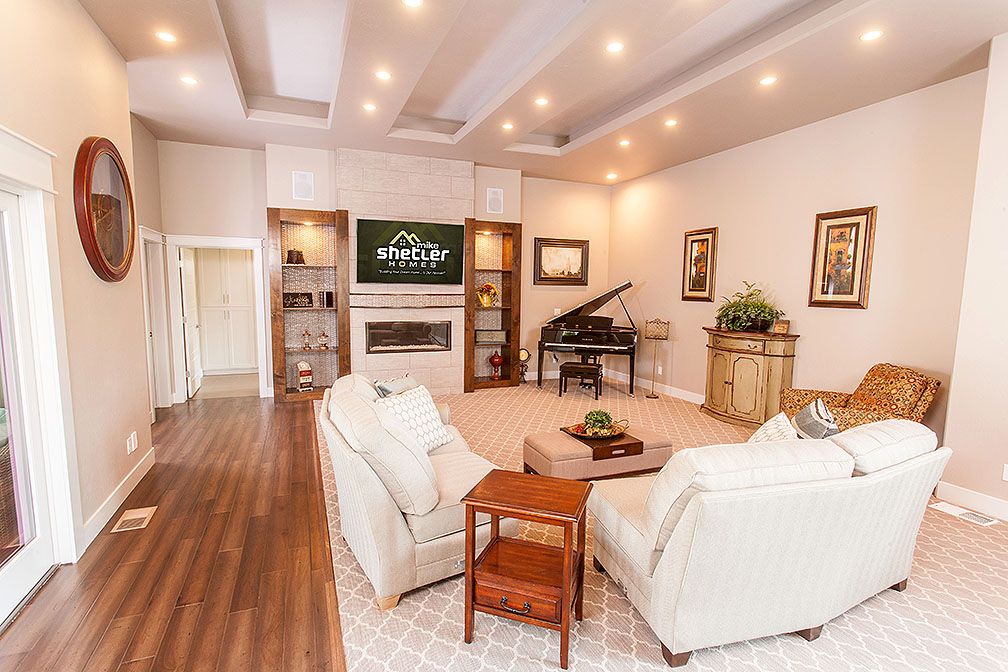 Great room has elegant patterned carpet and state-of-the-art fireplace making this room sophisticated yet cozy.