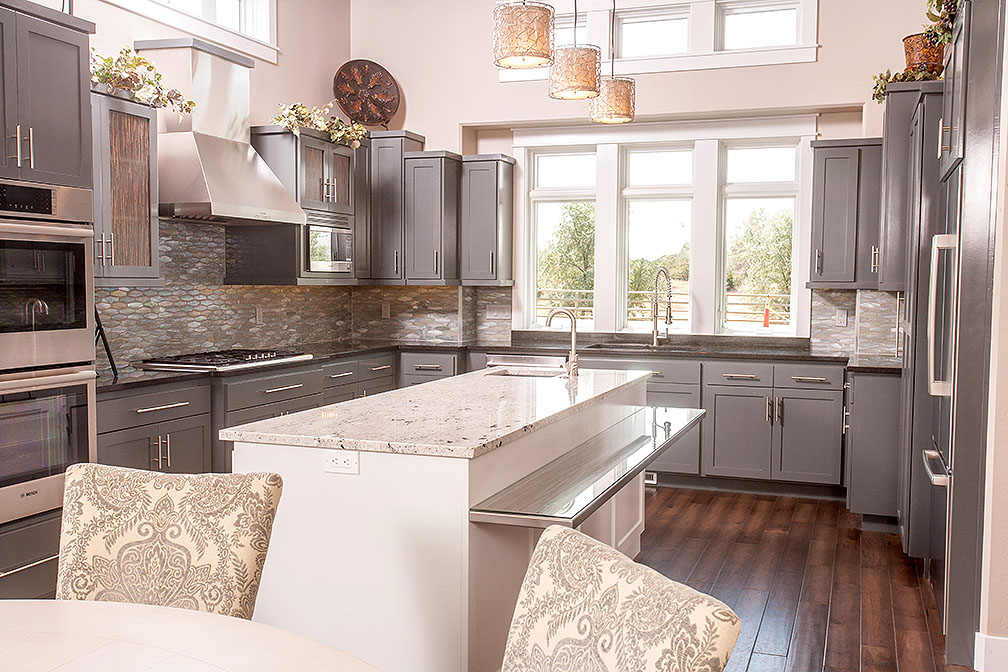 This perfect backsplash coupled with the stunning granite countertops make this kitchen exquisite.
