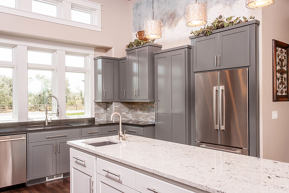 Gray shaker style cabinets with contrasting kitchen island