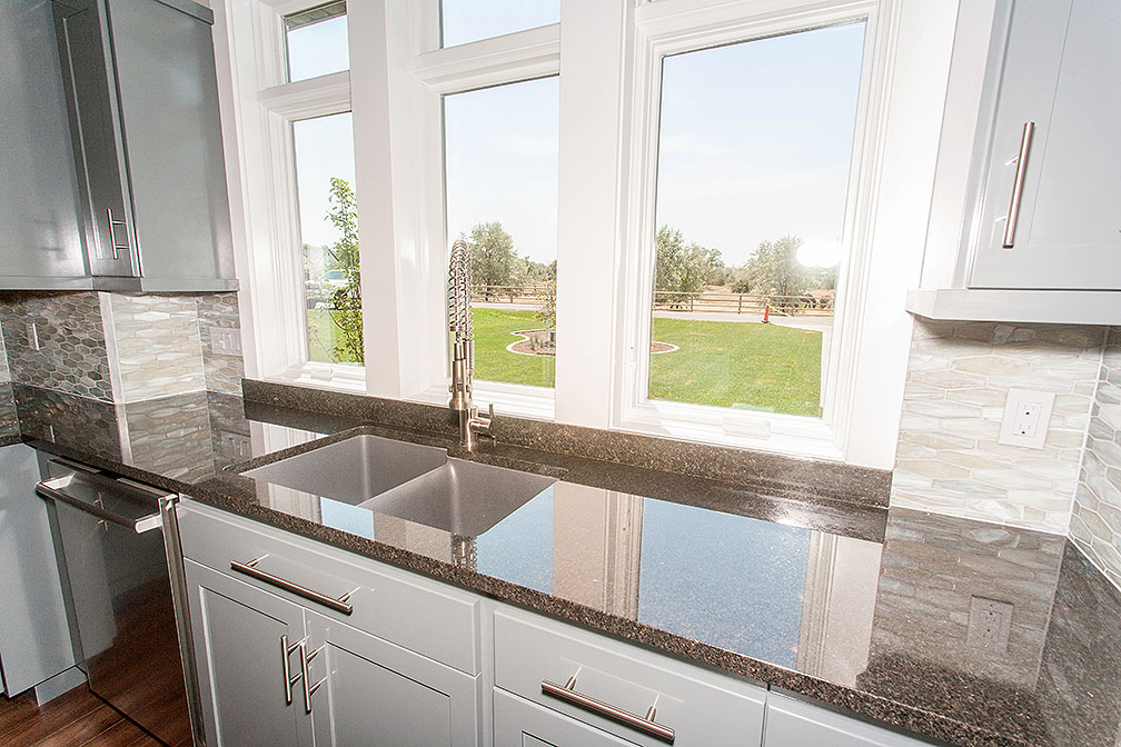 Natural light pours in to the kitchen through the custom cased windows