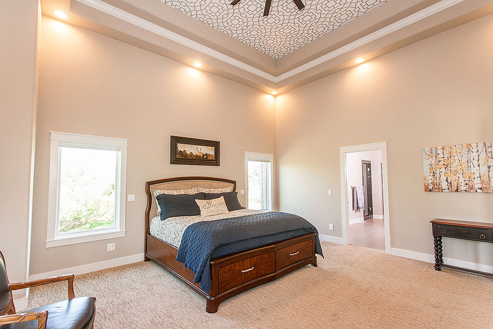 This spacious and intimate Master Bedroom has another intricately painted tray ceiling and premium designer carpet