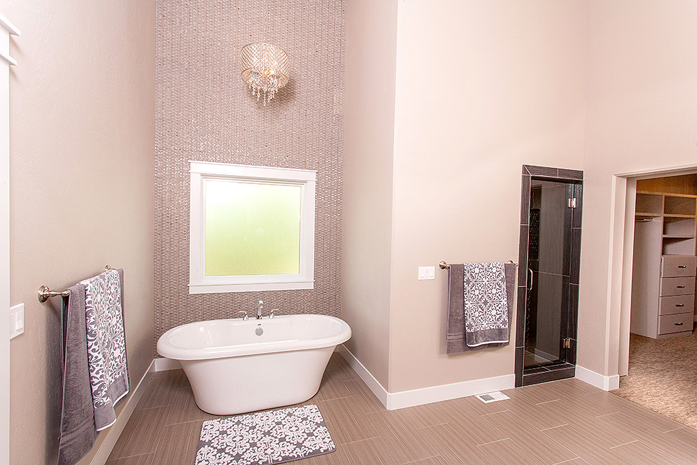 Oversized Master Bathroom with soaking tub and walk-in shower.