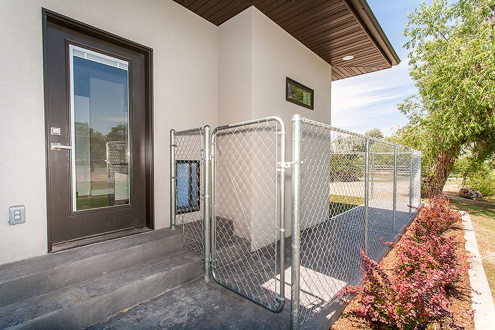 Pet door from the laundry room takes family pet outside to their own outdoor kennel.