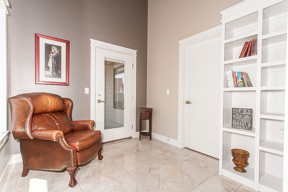 Reading nook with custom built shelving and elegant flooring.
