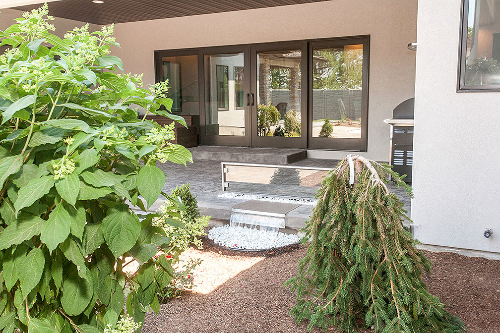 Courtyard with custom fire pit and water feature.