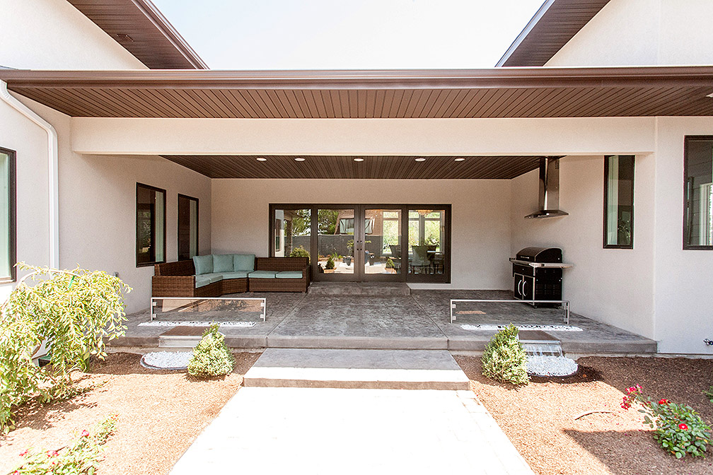 Courtyard with custom fire pit and water features.